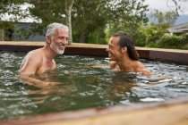 Father and son relaxing in hot tub — Stock Photo