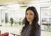 Portrait confident young businesswoman in office — Stock Photo