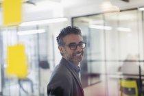 Portrait smiling, confident creative businessman in office — Stock Photo