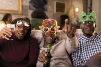 Portrait playful grandfather and grandsons wearing Christmas costume goggles — Stock Photo