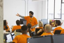 Hacker in turban leading meeting, coding for charity at hackathon — Stock Photo