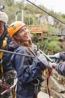 Portrait smiling, confident woman preparing to zip line — Stock Photo