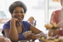 Portrait smiling, confident senior woman playing cards in community center — Stock Photo