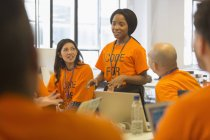 Hackers coding for charity at hackathon — Stock Photo