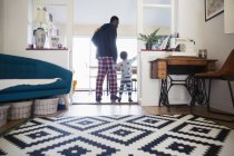 Rear view of african american father and son at home — Stock Photo