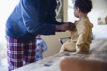Side view of african american father with little son at home — Stock Photo
