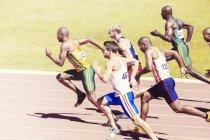 Sprinters racing on track — Stock Photo