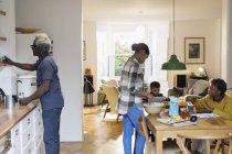 Grandparents and grandchildren baking in kitchen — Stock Photo