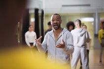 Dedicated male instructor teaching dance class in studio — Stock Photo