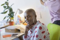Portrait confident, ambitious businesswoman at modern office — Stock Photo