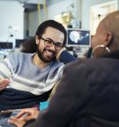 Smiling creative business people talking in office — Stock Photo