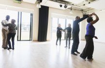 Active seniors dancing in dance class — Stock Photo
