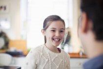 Happy, enthusiastic girl indoors — Stock Photo
