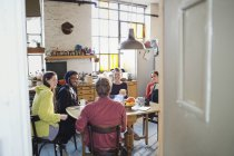 Young roommate friends at breakfast table in apartment kitchen — Stock Photo