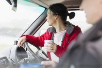 Woman with coffee driving motor home — Stock Photo