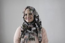 Portrait smiling, confident woman wearing floral hijab — Stock Photo