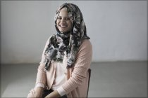 Portrait smiling, confident woman in floral hijab — Stock Photo