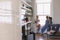 Young women friends talking in house rental window — Stock Photo