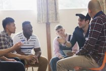 Men talking n group therapy circle — Stock Photo