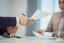 Business people with paperwork in meeting — Stock Photo