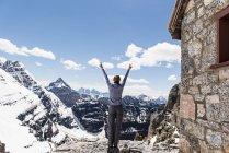 Exuberant female hiker on sunny, snowy mountaintop, Yoho Park, British Columbia, Canada — Stock Photo