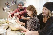 Family baking in kitchen — Stock Photo