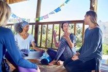 Women talking in hut during yoga retreat — Stock Photo