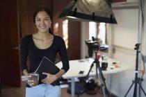 Portrait confident female photographer working in studio — Stock Photo