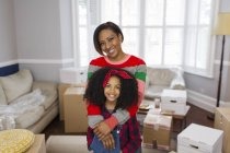 Portrait happy mother and daughter moving house — Stock Photo