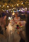 Friends celebrating birthday at garden party table — Stock Photo