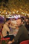 Portrait happy man enjoying dinner garden party — Stock Photo
