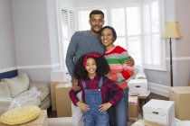 Portrait happy family moving house — Stock Photo