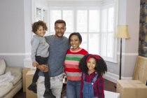 Portrait happy family moving house — Stock Photo