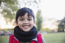 Portrait enthusiastic, cute boy in park — Stock Photo