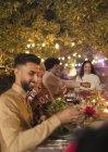 Friends enjoying dinner garden party — Stock Photo