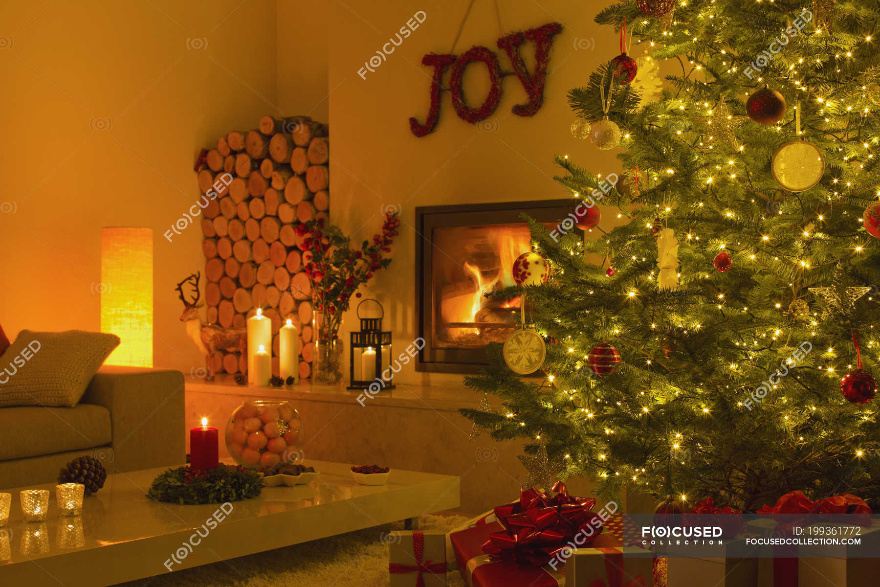 Ambient Fireplace And Candles In Living Room With Christmas Tree