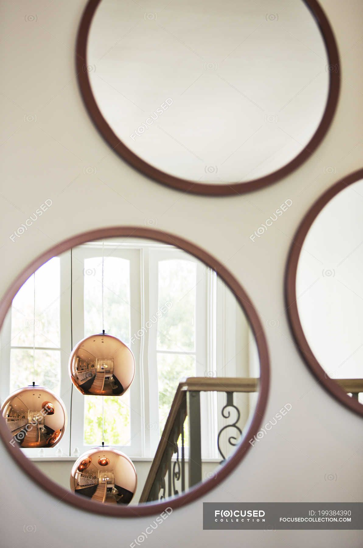 Reflection Of Copper Pendant Lights In Round Mirrors Design View Stock Photo 199384390