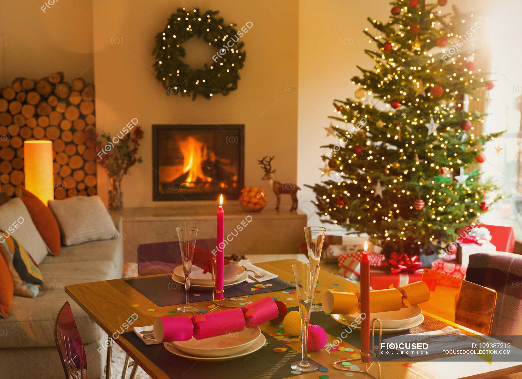 Ambient Dining Table Fireplace And Christmas Tree In Living Room