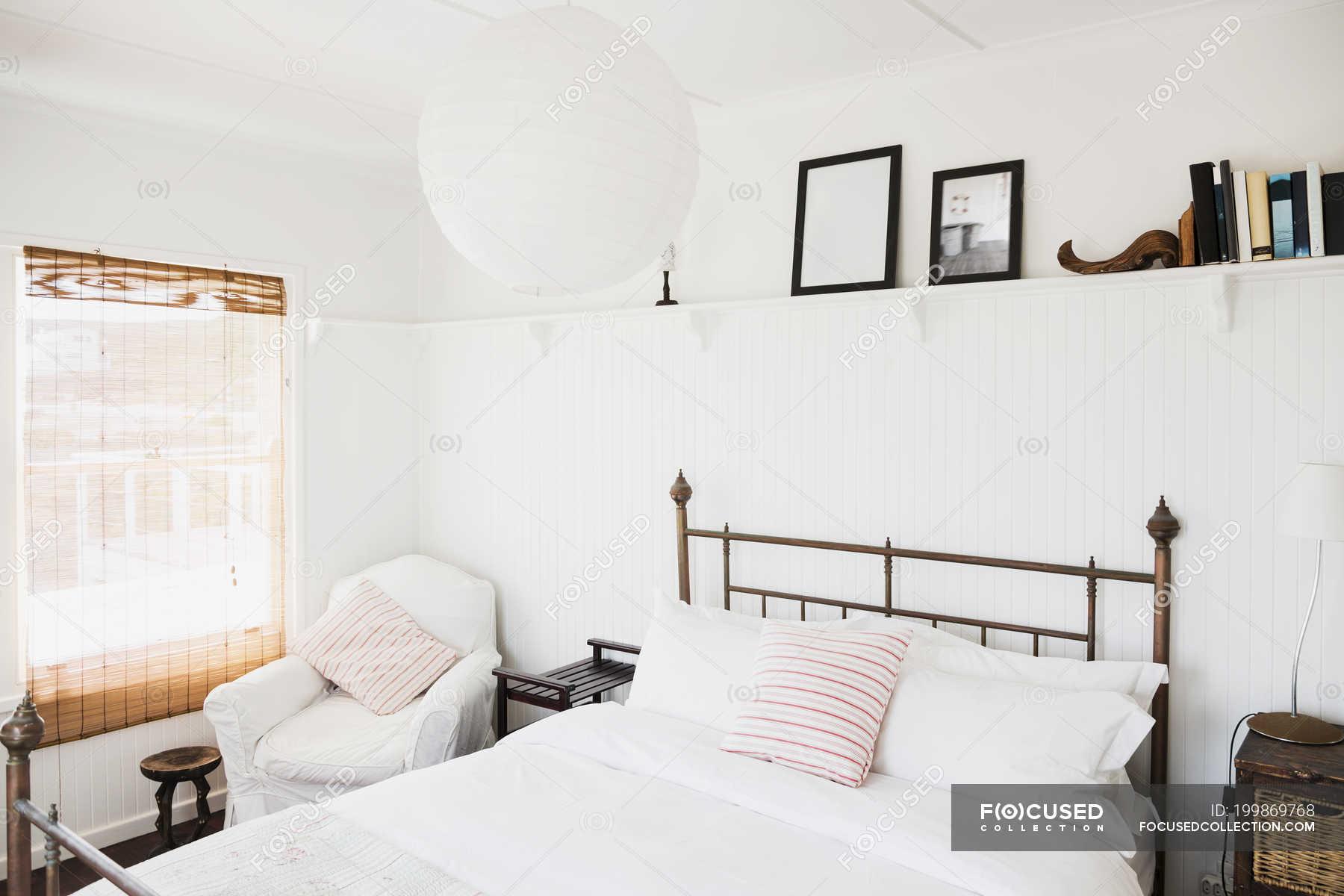 Shelf Above Bed In White Bedroom Interior Design Indoors Stock Photo 199869768
