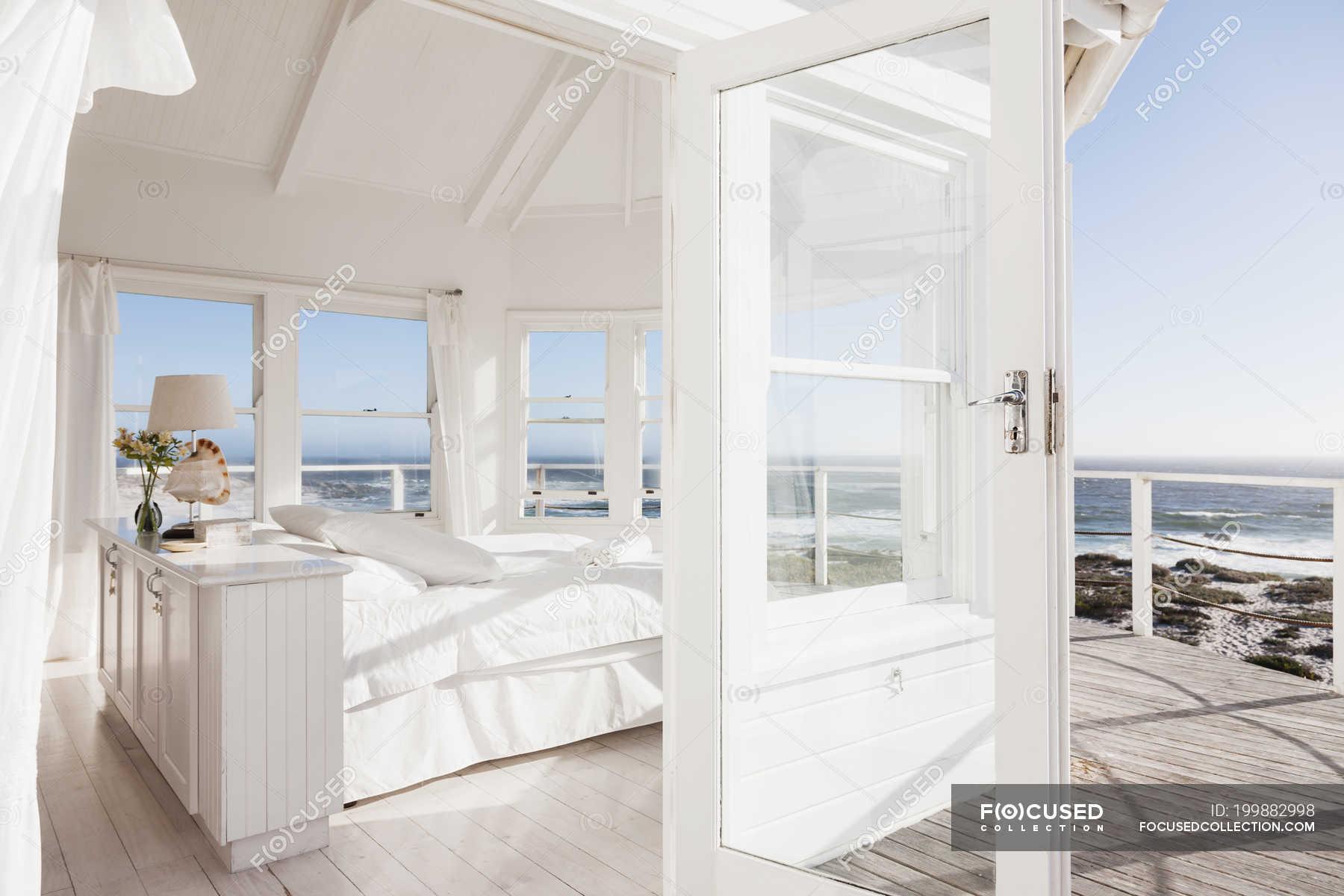 Scenic View Of White Bedroom Overlooking Ocean Absence Luxury Stock Photo 199882998