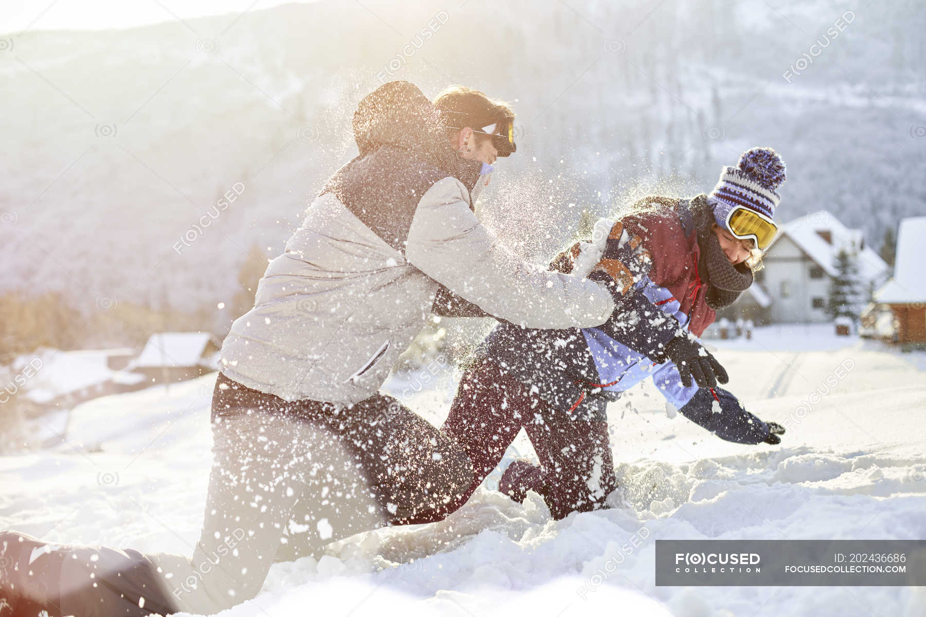 Young couple holding snow ball stock image