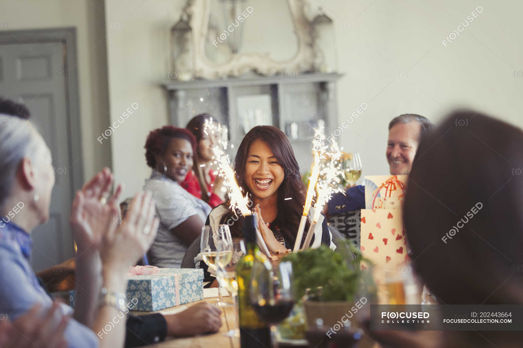 Astonishing Friends Watching Happy Woman With Fireworks Birthday Cake At Funny Birthday Cards Online Bapapcheapnameinfo