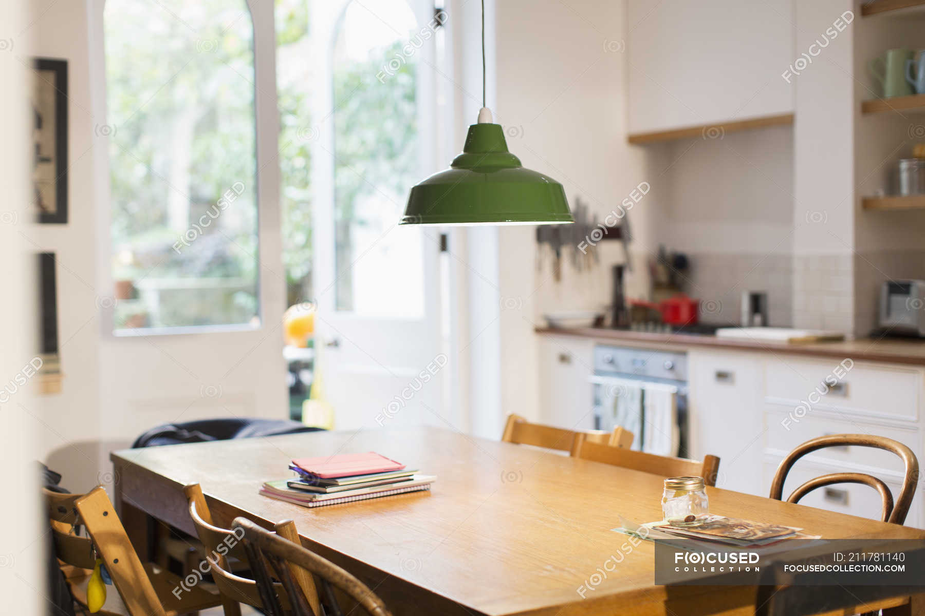 Green Pendant Light Hanging Over Dining