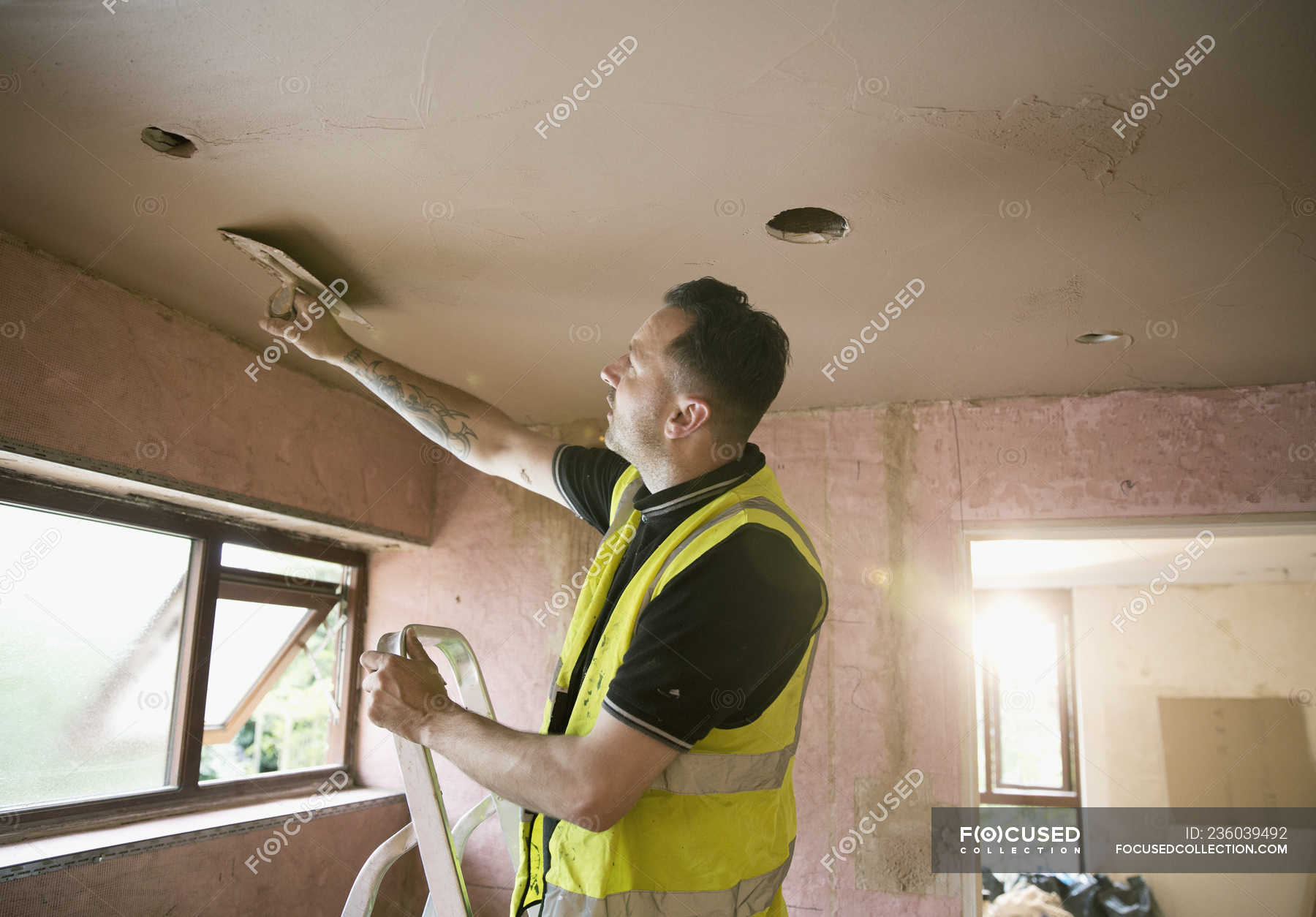 Construction Worker Plastering Ceiling
