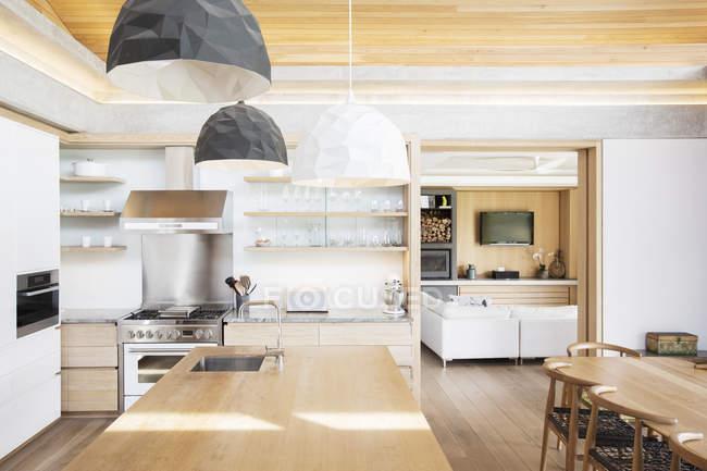 Modern pendant lights over wood kitchen island — Stock Photo