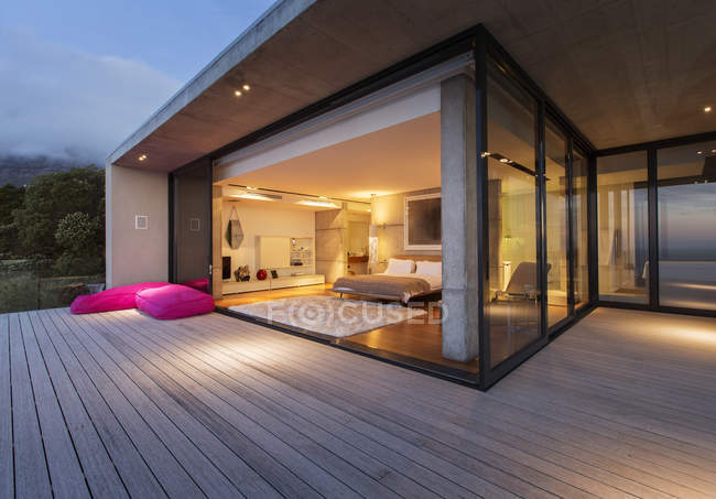 Sliding glass doors onto bedroom of modern house — Stock Photo
