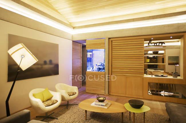 Illuminated tray ceiling over living room — Stock Photo
