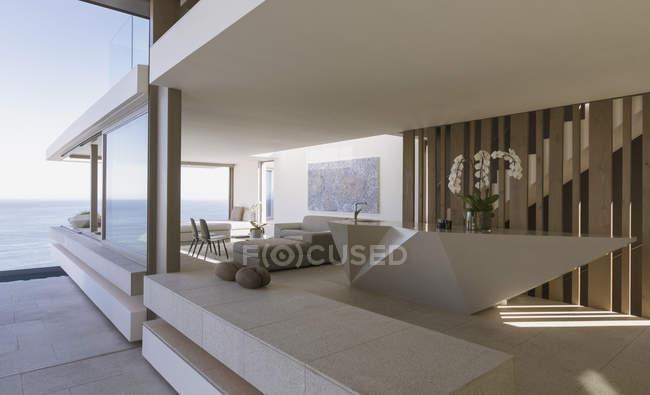 Modern, luxury home showcase interior with ocean view — Stock Photo