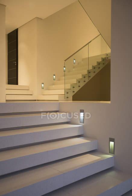 Modern staircase illuminated at night — Stock Photo