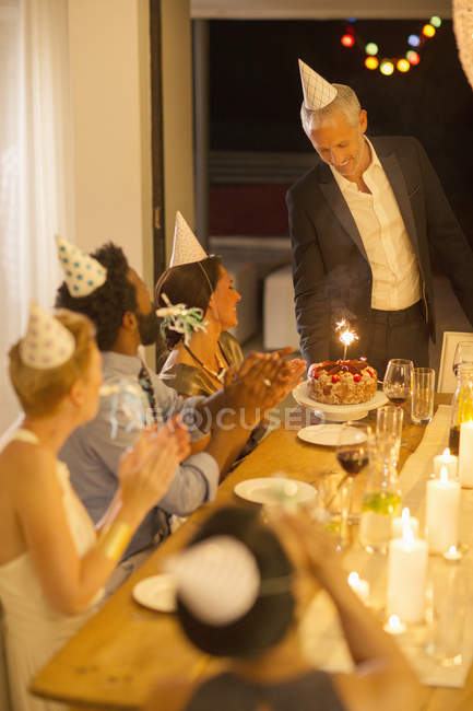 Man serving birthday cake at party — Stock Photo